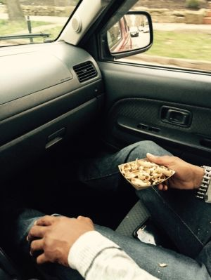 Said individual holding peanut remnants.  Photo by author, taken at a red light.
